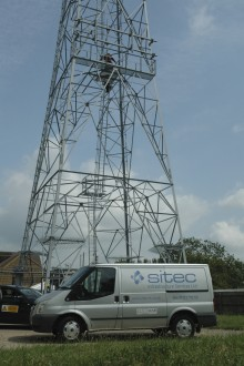 Sitec Van parked in front of a pylon