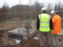 Two men setting out a construction
