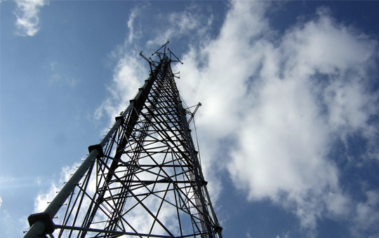 Acquisitions case study with a telecoms tower looking up
